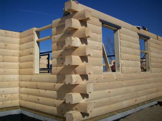 b320d13ee23 This log home under construction is designed and manufactured by Real Log  Homes